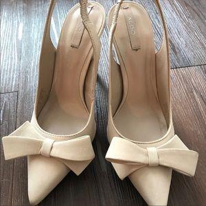 Nude suede bow heels